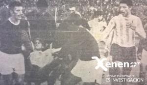 Oscar Martín desmayado. Lo sacan los propios jugadores granates.